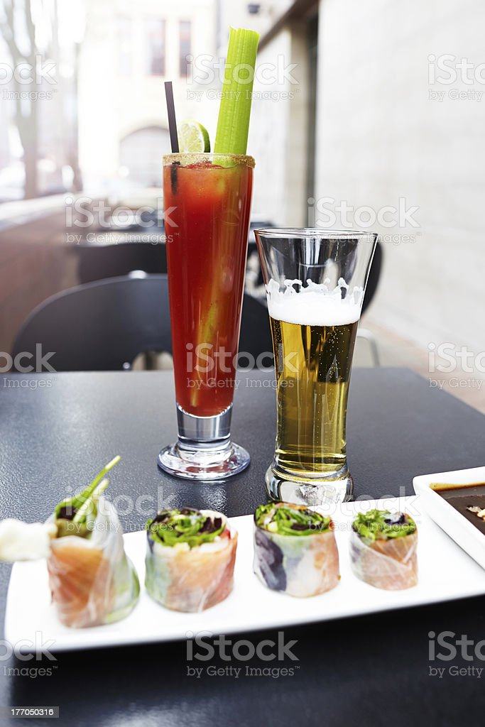 Salad rolls plate with beer and caesar cocktail drinks outdoor stock photo