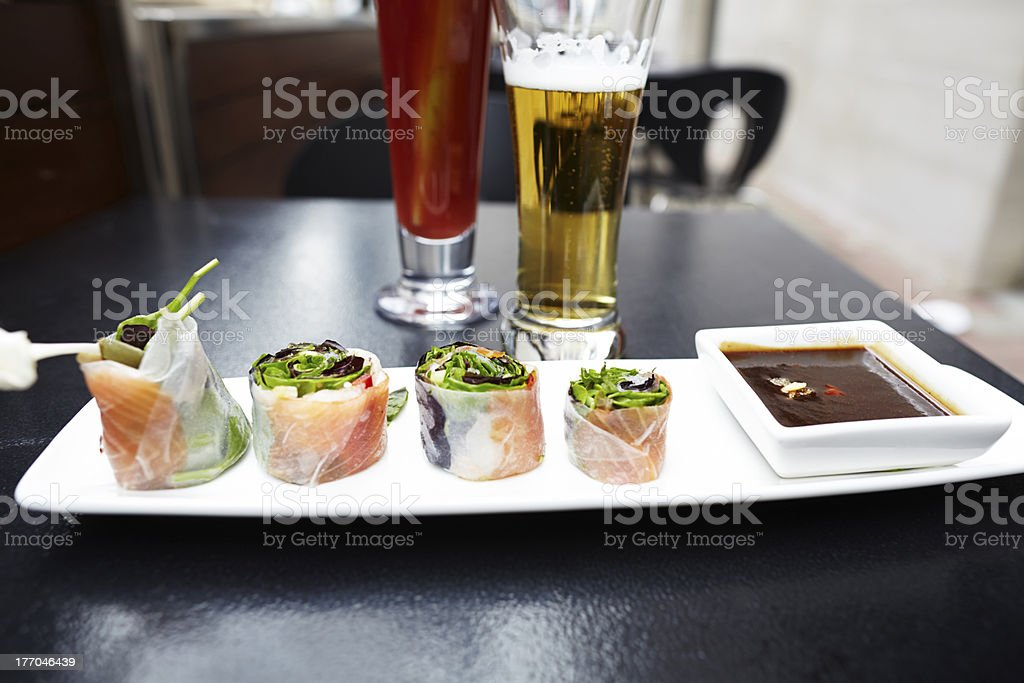 Salad rolls plate with beer and caesar cocktail drinks stock photo