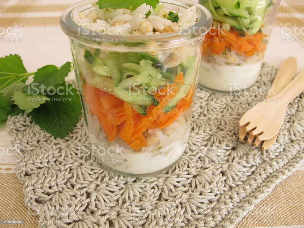 Salad to go with rice, barley, carrot and cucumber stock photo