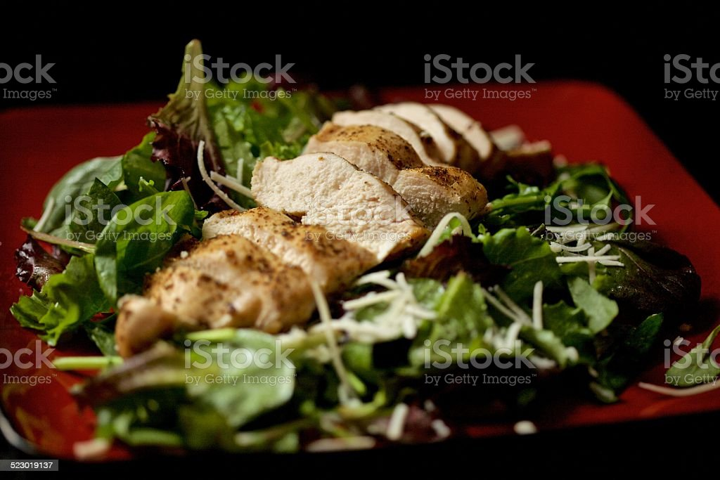 Salad topped with chicken stock photo