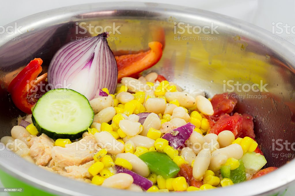 Salad vegetables, tomatoes , corn , red onion and cucumber. stock photo