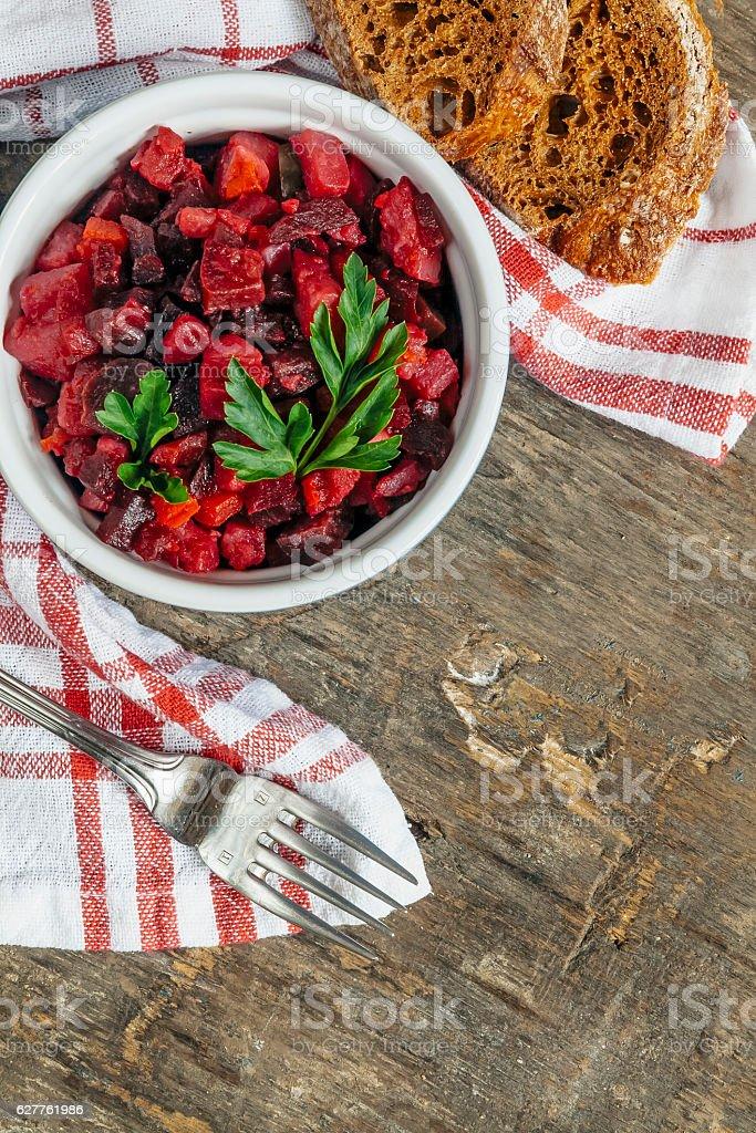 salad vinaigrette on a napkin on a rustic background close-up stock photo