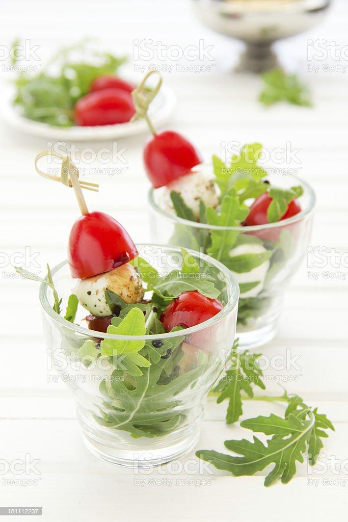 Salad with arugula, mozzarella and tomatoes. royalty-free stock photo