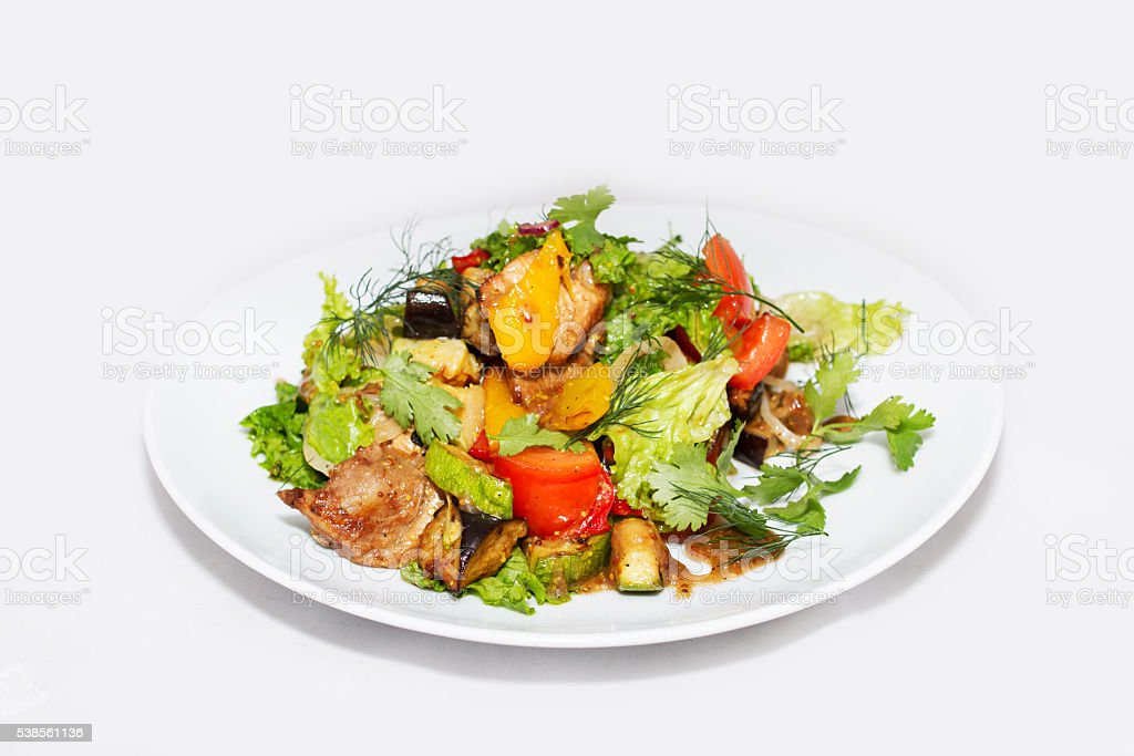 Salad with aubergine and meat on a plate stock photo