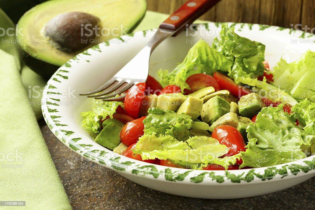 salad with avocado and cherry tomatoes royalty-free stock photo