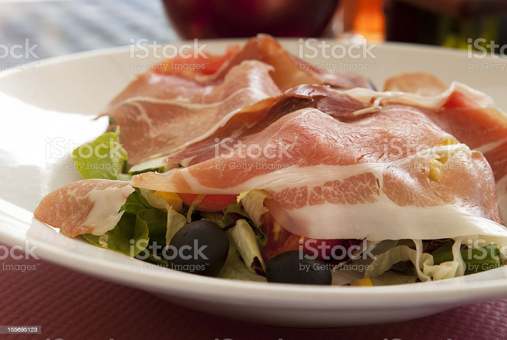 Salad with bacon and olives royalty-free stock photo