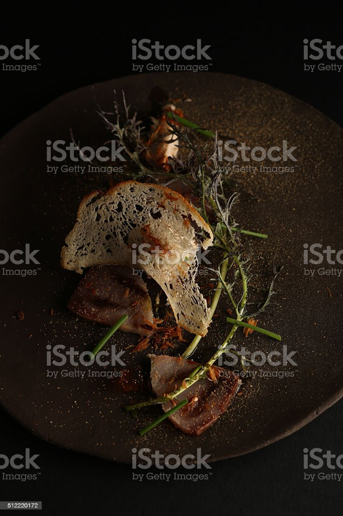 Salad with bacon, croutons and sauces on the plate stock photo