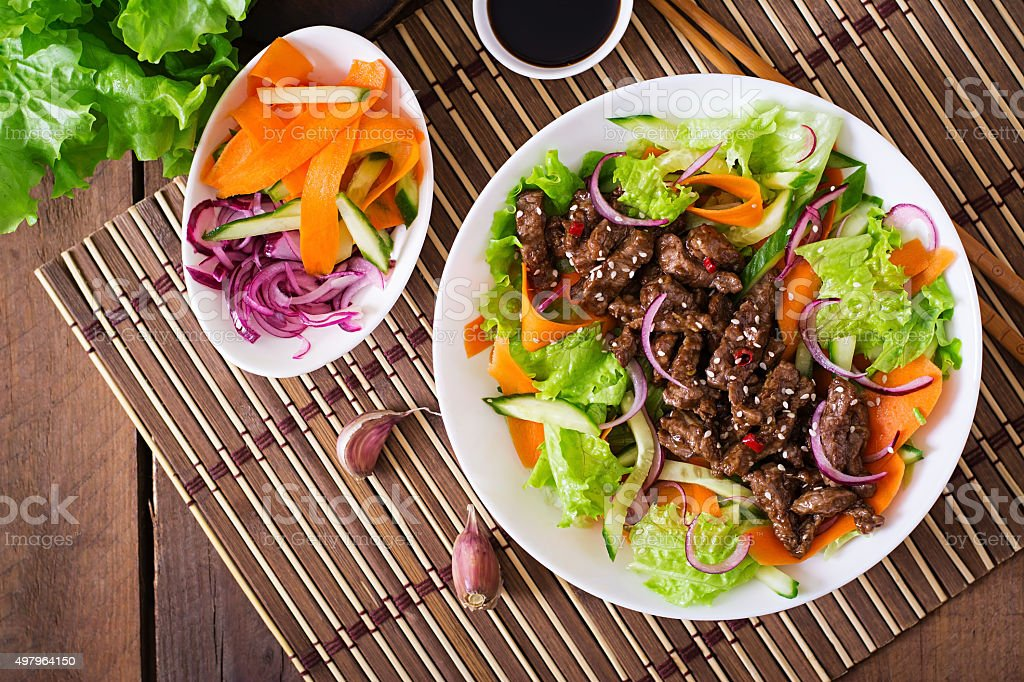 Salad with beef teriyaki stock photo