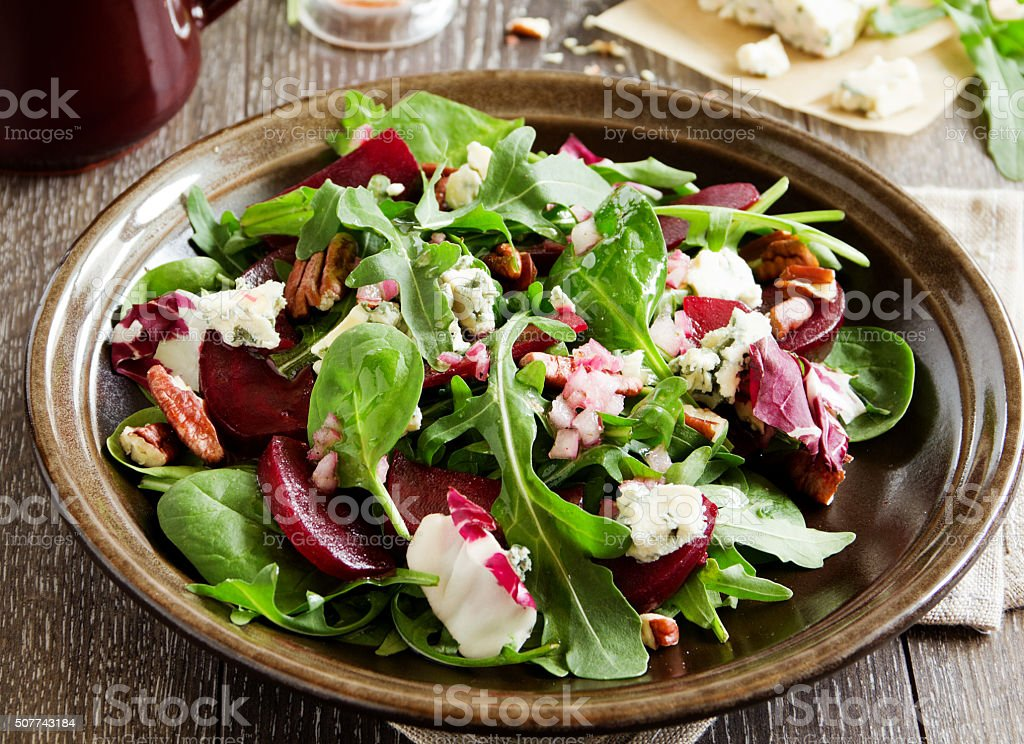 Salad with beet, blue cheese, nuts and vinaigrette. stock photo