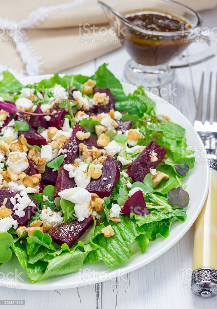 Salad with beets, feta cheese and walnuts stock photo