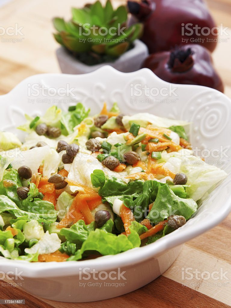 Salad with carrots, arugula and capers royalty-free stock photo