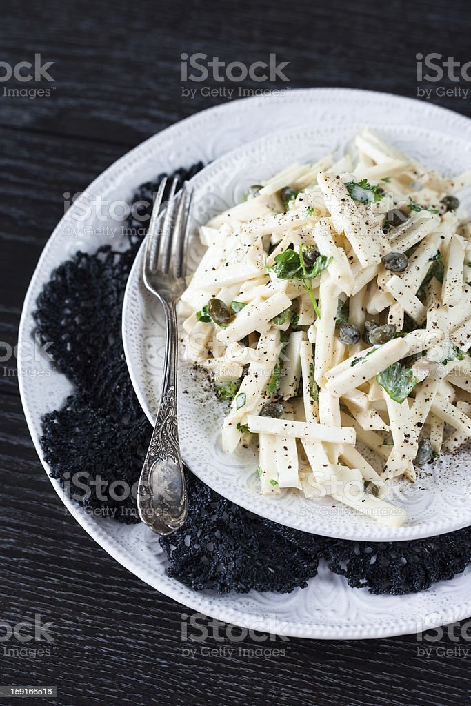 Salad with Celery Root, Capers, and Homemade Mayonnaise Dressing royalty-free stock photo
