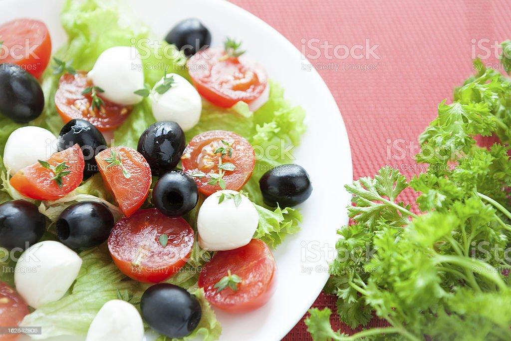 salad with cherry tomatoes and mozzarella caprese royalty-free stock photo