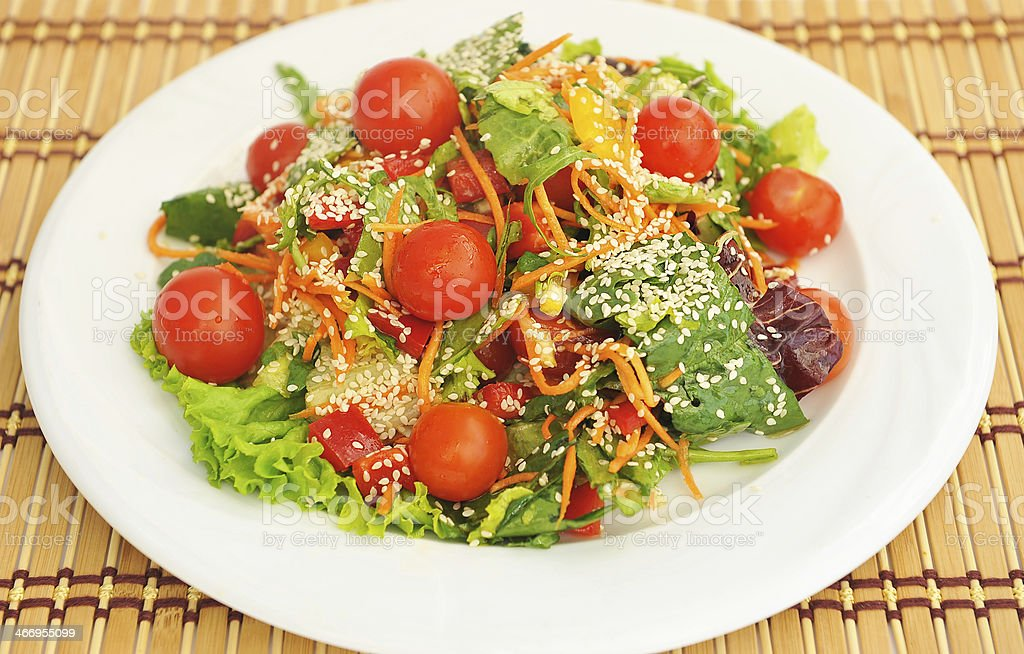 Salad with cherry tomatoes and sesame . royalty-free stock photo