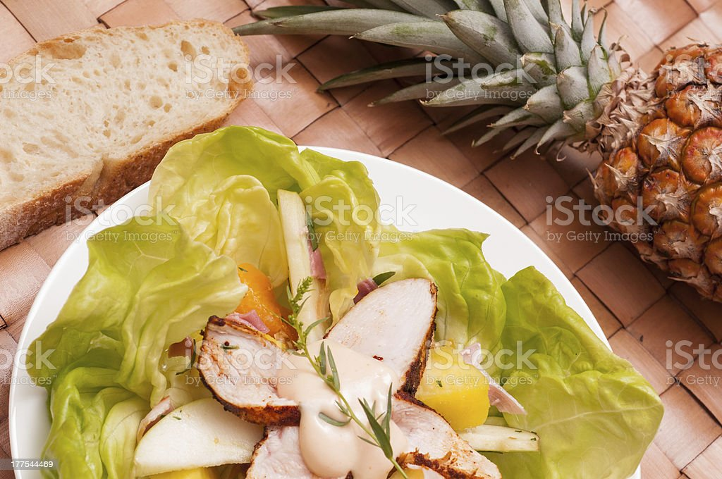 Salad with chicken and fruits stock photo