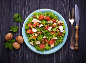 Salad with chicken and grapefruit