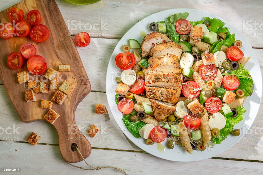 Salad with chicken and vegetables stock photo