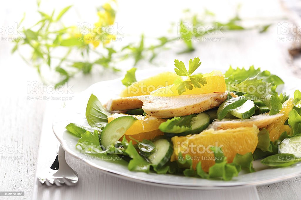 salad with chicken, orange and cucumber stock photo