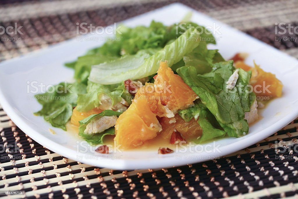 Salad with chicken, oranges, honey and almonds stock photo