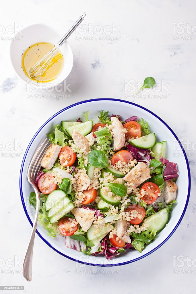 Salad with chicken, vegetables and bulgur stock photo