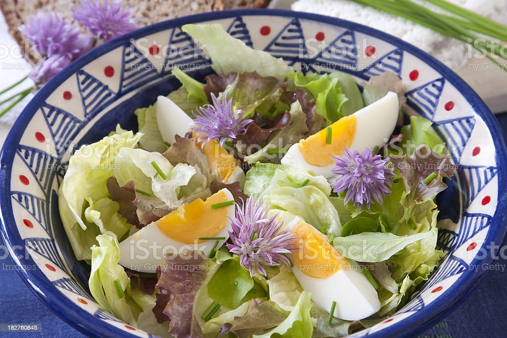 salad with chive blossom stock photo
