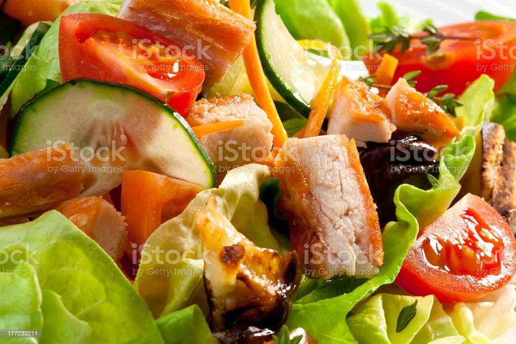 Salad with coated chicken pieces stock photo