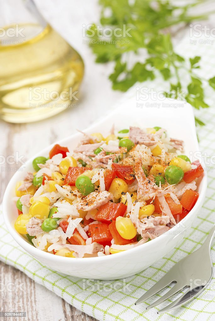 salad with corn, green peas, rice, red pepper and tuna stock photo
