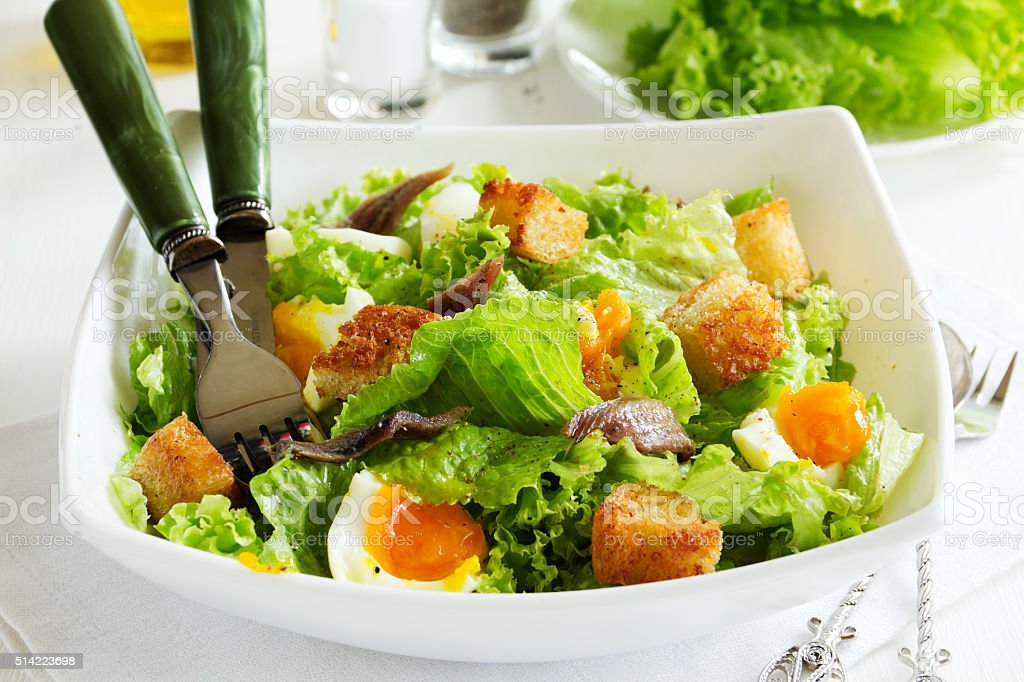 Salad with croutons, anchovies and eggs. stock photo