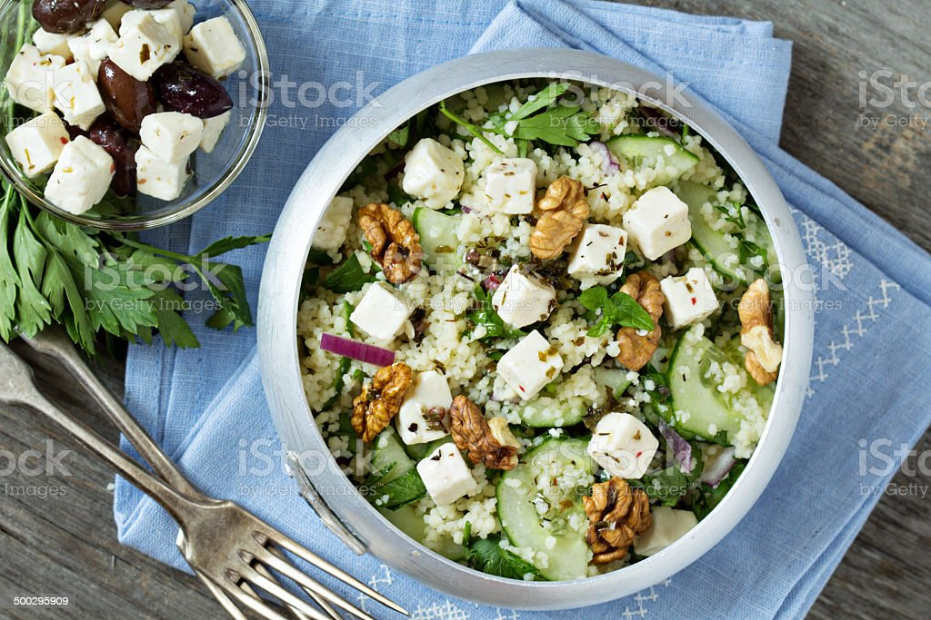 Salad with cucumber, couscous and feta stock photo