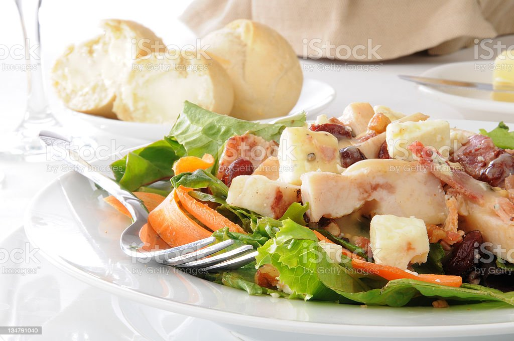 Salad with dinner rolls stock photo
