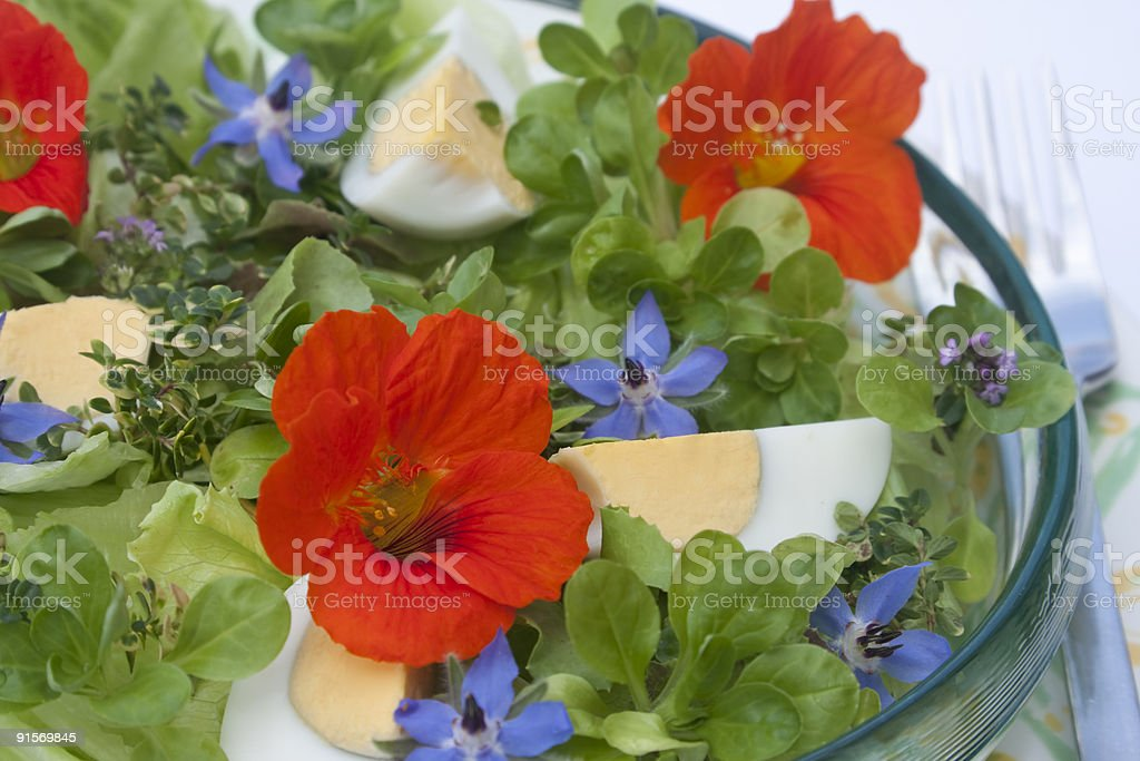 Salad with edible flowers stock photo