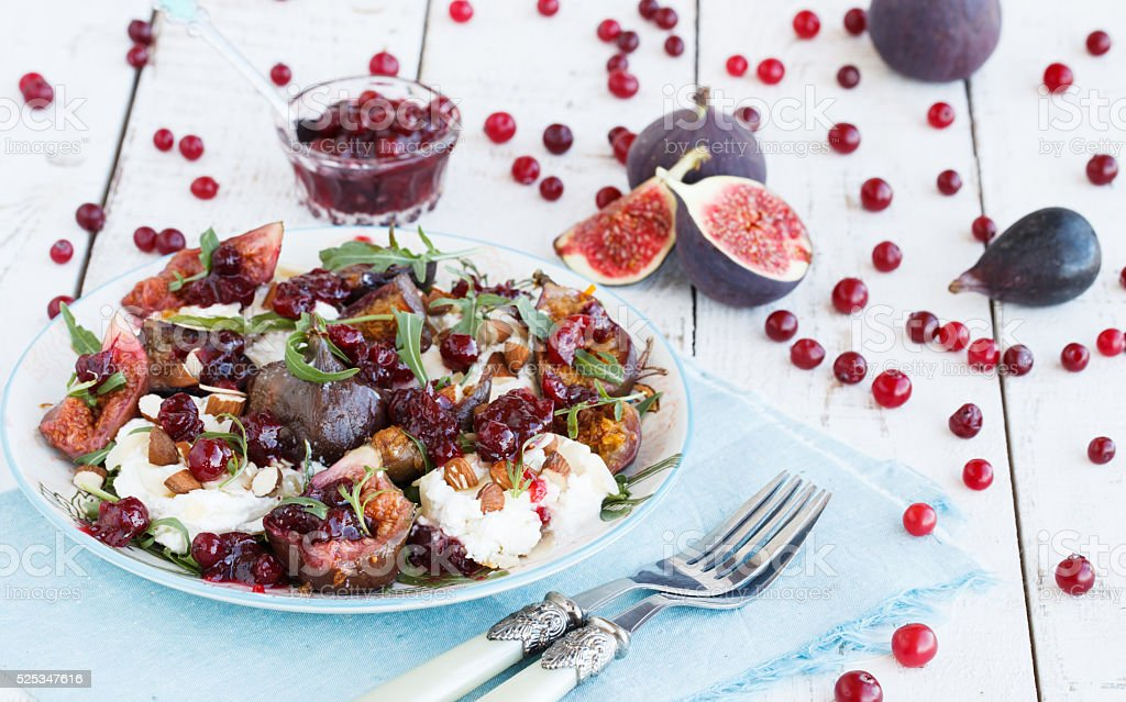 Salad with figs and arugula stock photo
