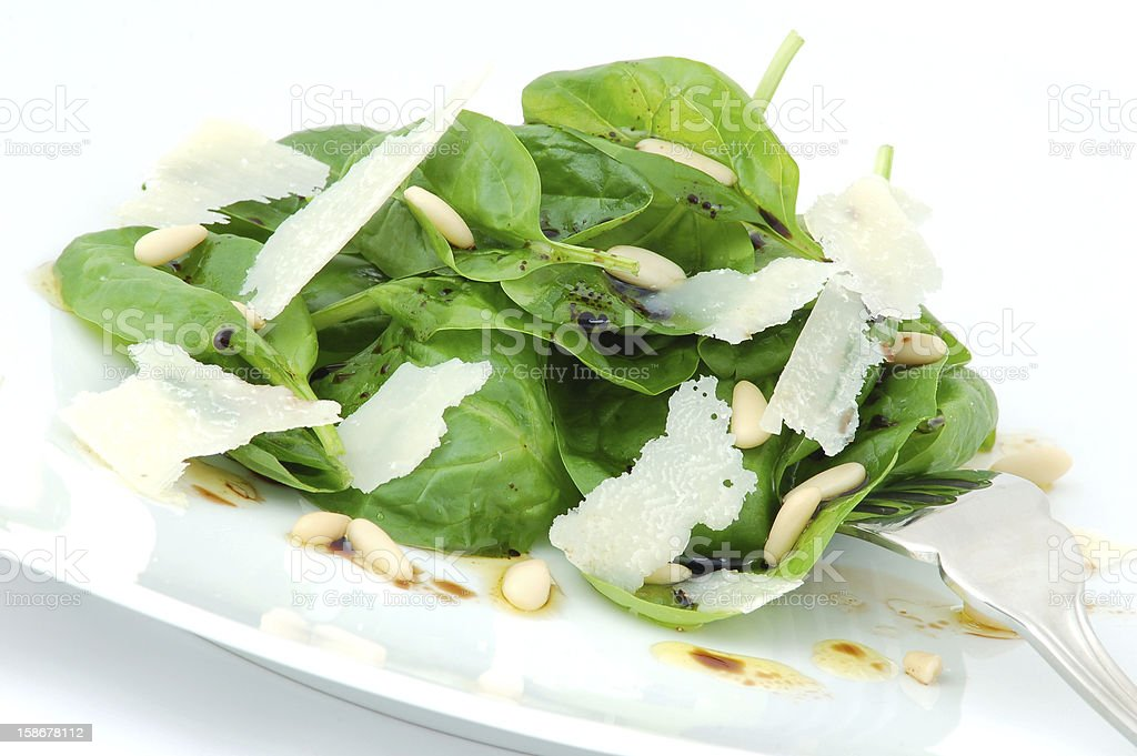 Salad with fresh spinach and parmesan close up royalty-free stock photo