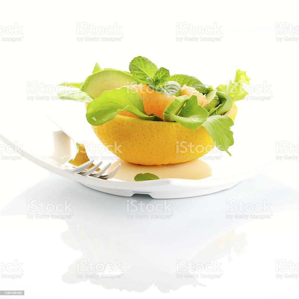 Salad with grapefruit and avocado on white isolated background stock photo
