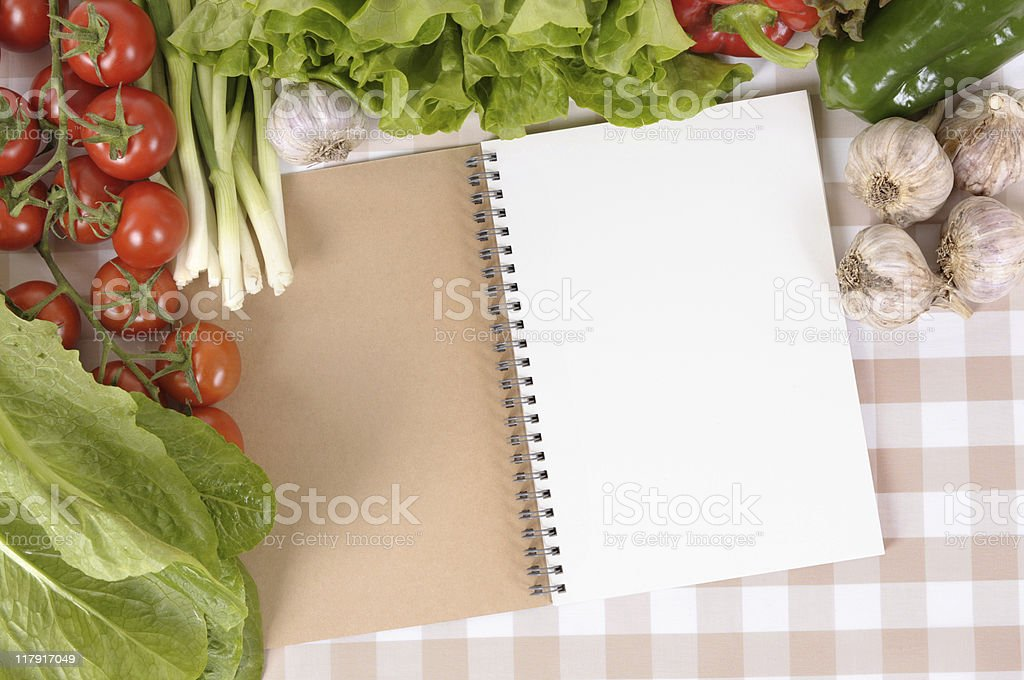 Salad with open notebook royalty-free stock photo