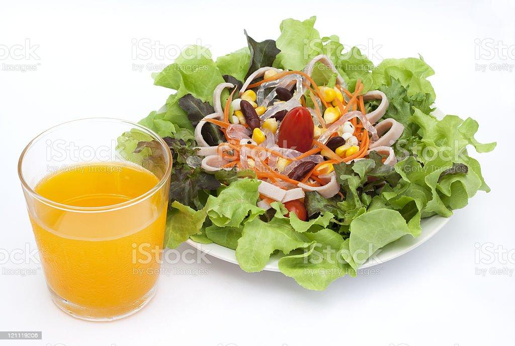 Salad with orange juice stock photo