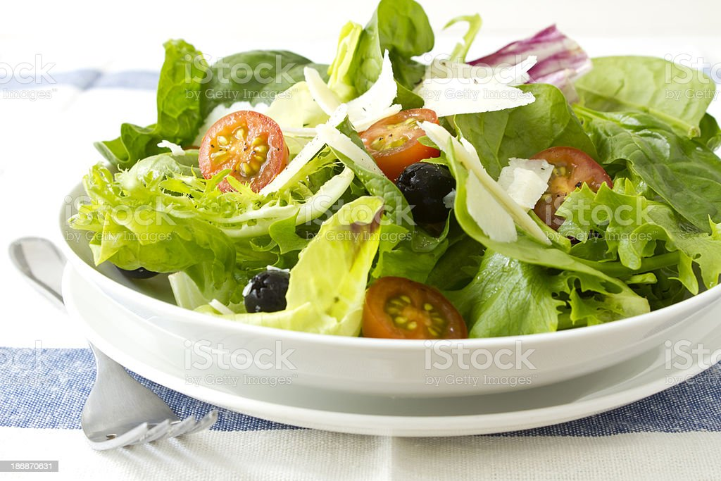 Salad with parmesan and olives royalty-free stock photo