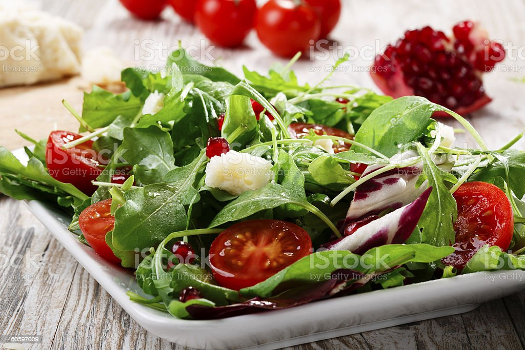 salad with Parmesan cheese and pomegranate stock photo