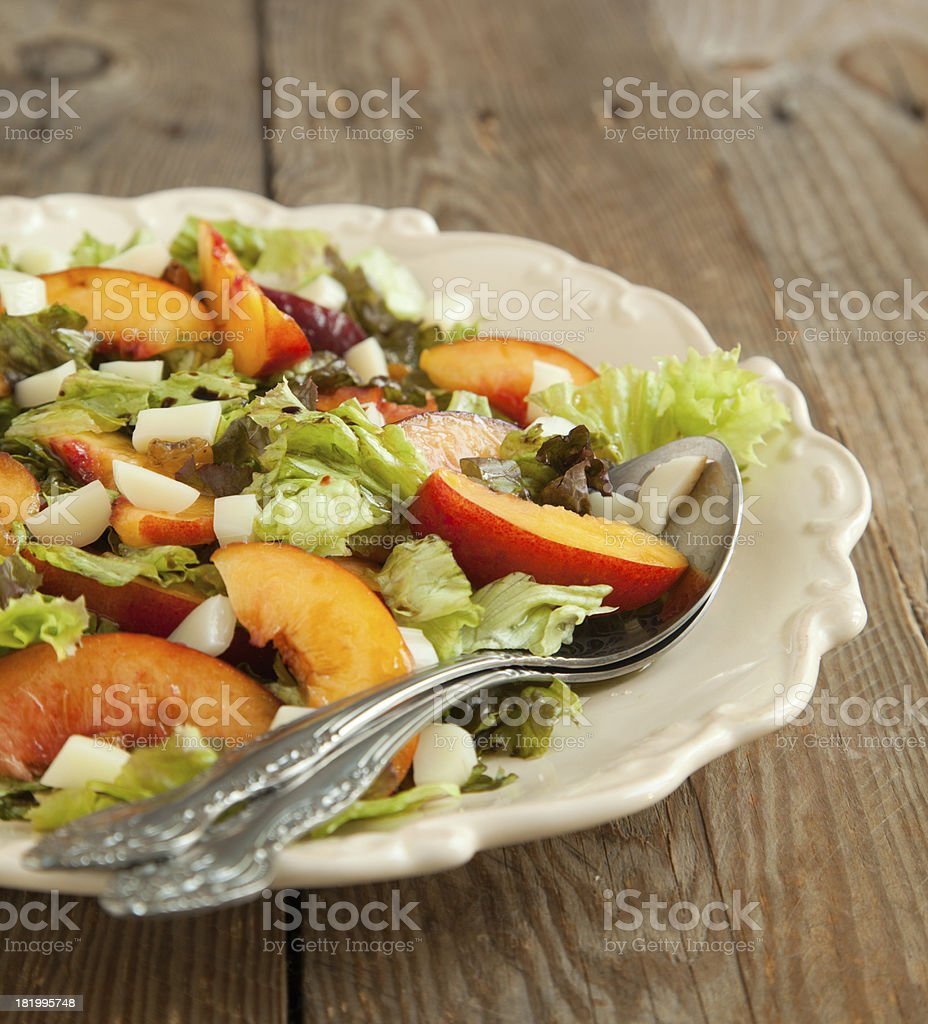 Salad with peach and mozarella royalty-free stock photo