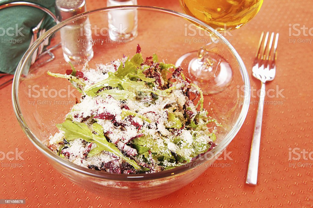 Salad with peppery arugula and radiccio in a glass dish stock photo