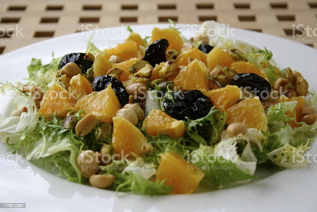 Ensalada con ciruelas y naranja royalty-free stock photo