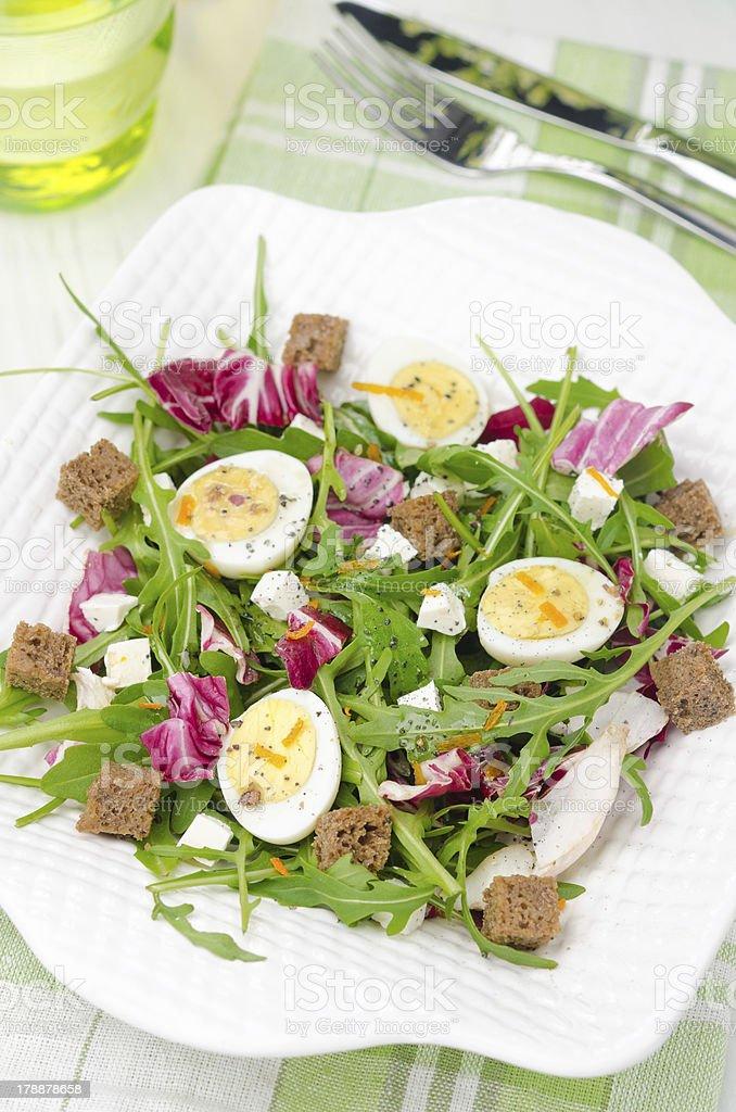 salad with quail eggs, feta and arugula, top view royalty-free stock photo