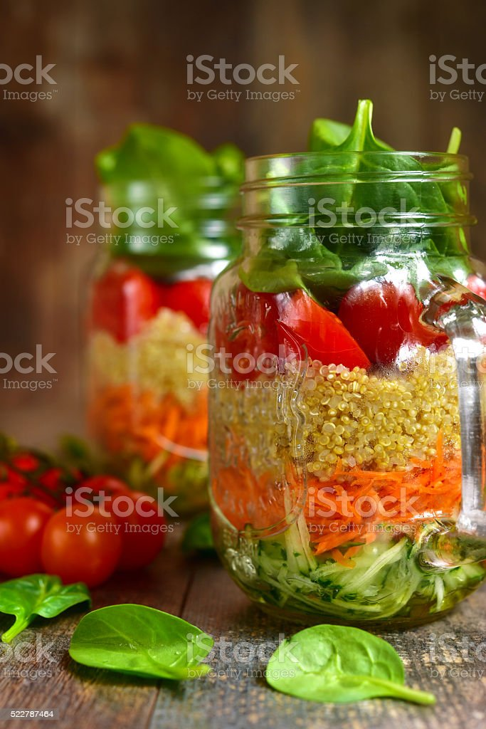 Salad with quinoa and vegetables in a mason jar. stock photo