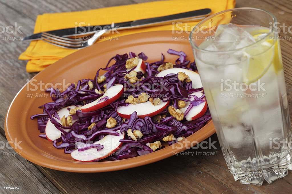 Salad with red cabbage, apples, and walnuts royalty-free stock photo