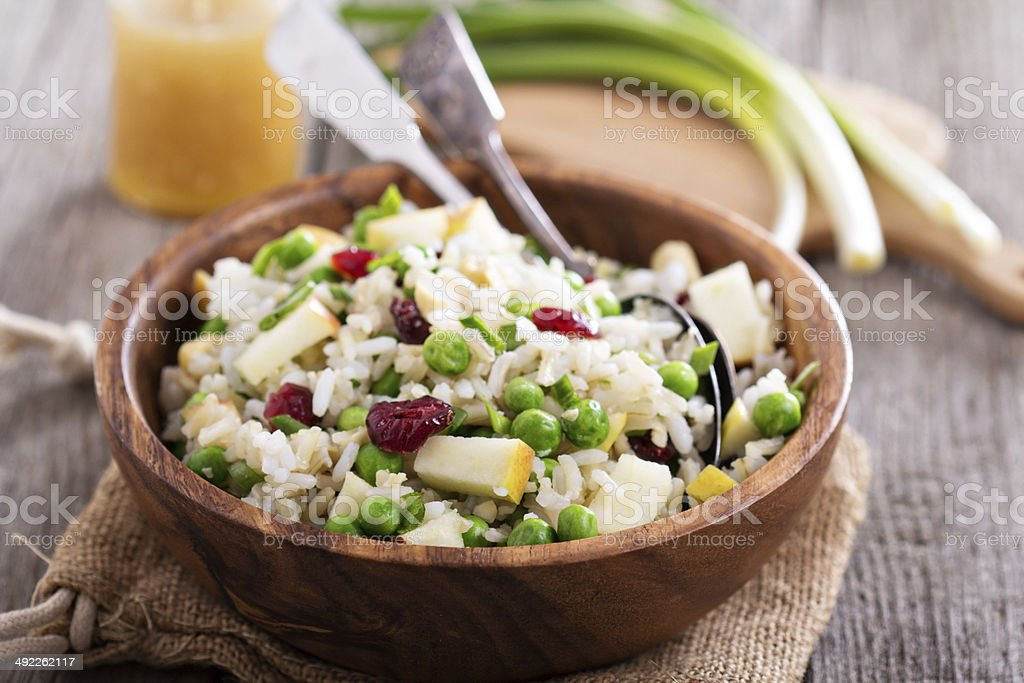 Salad with rice, apple, cranberry and peas stock photo
