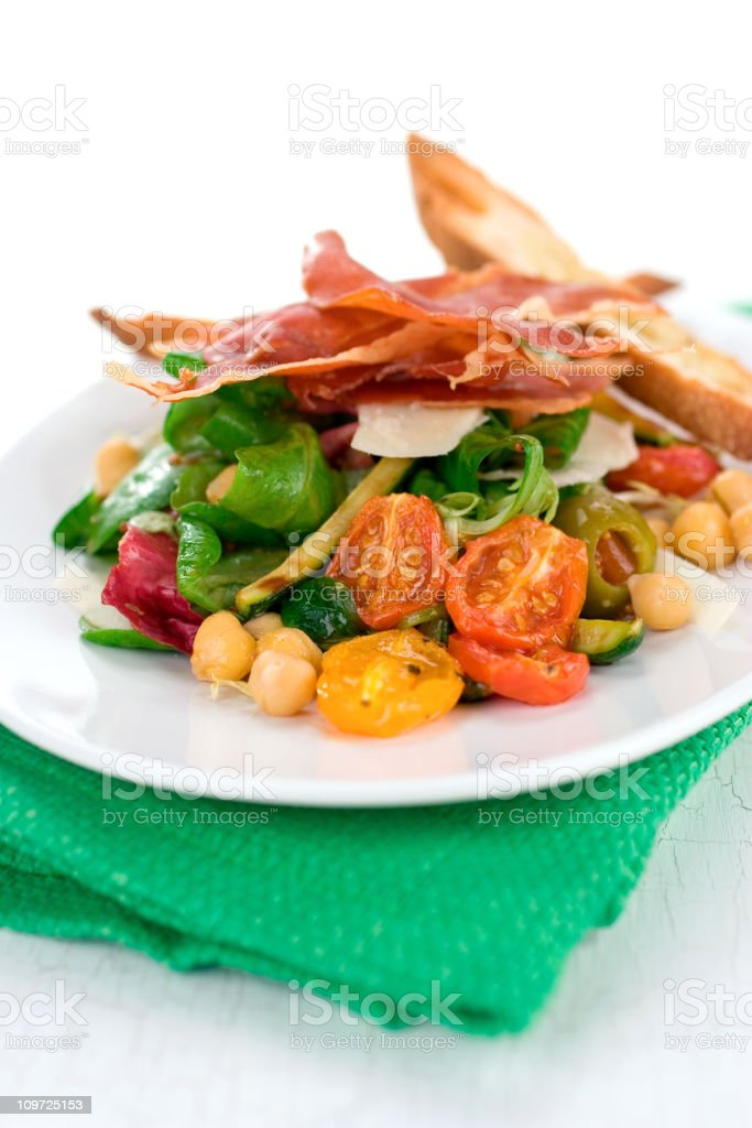 Salad with Roasted Vegetables and Prosciutto royalty-free stock photo