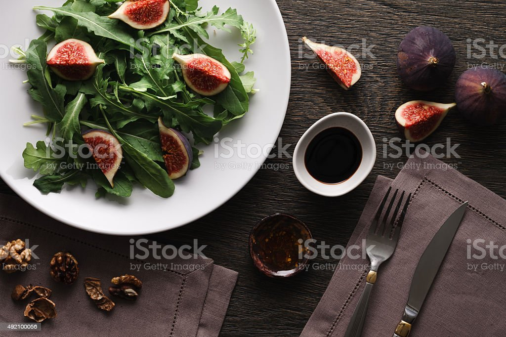 Salad with rocket leaves and figs stock photo