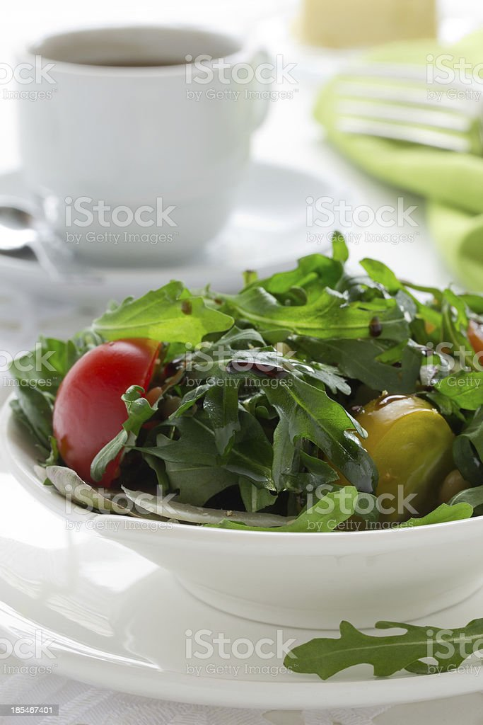 Salad with ruccola and tomatoes. royalty-free stock photo