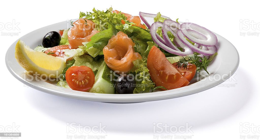 Salad with salmon served on white plate royalty-free stock photo