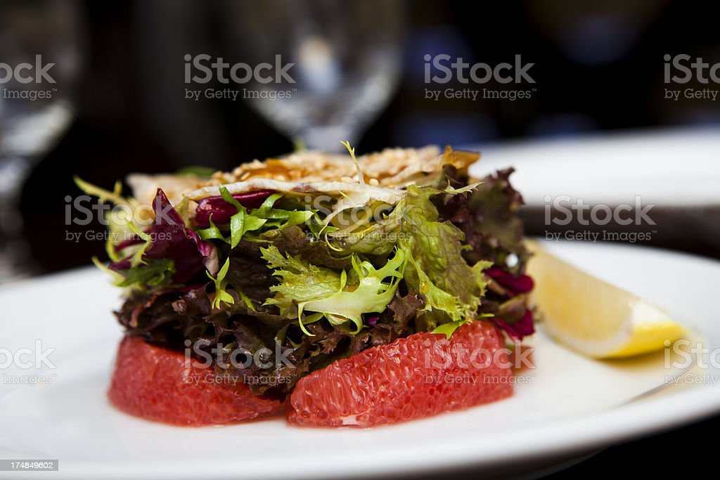 Salad with smoked eel and grapefruit royalty-free stock photo